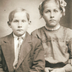 "Siblings, Henry John Schmidt (1904-1974) and Anna Margaret Schmidt (1902-1983) (after marriage to take on the last name Krug).  Henry and Anna were two of the children of Georg Karl Schmidt and Anna Margaretha ""Maggie"" (Lindemann) Schmidt. Henry and Anna were the grandchildren of Dietrich Schmidt Jr., great grandchildren of Dietrich Schmidt Sr., 2xgreat grandchildren of Friedrich Schmidt, 3xgreat grandchildren of Johannes Schmidt Jr., 4xgreat grandchildren of Johannes Schmidt Sr., 5xgreat grandchildren of Hans Heinrich Schmidt, and 6xgreat grandchildren of Hans Schmidt.  Photo courtesy of Denise Lindemann"