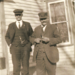 "John A. Lindeman (1870-1933) of Vinton, Iowa, and his first cousin once removed Georg Karl ""Chas"" Schmidt (1864-1933) of West Bend, Iowa.  John was also a first cousin of Karl's wife, Maggie (Lindemann) Schmidt. Karl lived for several years in the Vinton area after he first immigrated to America in the 1880s.  This photo was taken in Humboldt, Iowa at the farm of Mike Lindemann (John's first cousin, and Karl's brother-in-law).  Karl was the son of Dietrich Schmidt Jr., grandson of Dietrich Schmidt Sr., great grandson of Friedrich Schmidt, 2xgreat grandson of Johannes Schmidt Jr., 3xgreat grandson of Johannes Schmidt Sr., 4xgreat grandson of Hans Heinrich Schmidt, and 5xgreat grandson of Hans Schmidt.  Photo courtesy of Denise Lindemann"