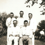 "(Left to right)  (Back row) Carl Michael Lindemann (1898-1991), Chris Emil Schmidt (1901-1976), Henry William Lindeman(n) (1906-1989).  (Front row) Herman H. Lindemann (1901-1957), Earnest Daniel ""Bud"" Schmidt (1909-1993).  The Lindeman/Lindemann boys were brothers. Chris and Bud Schmidt were brothers. The two groups of brothers were first cousins of one another. Photo was taken at the 50th wedding anniversary party of Mike and Lizzie Lindemann, held on their son Carl Lindemann's farm near Humboldt, Iowa in July 1937.  The Schmidt boys were sons of Henry and Mary (Moser) Schmidt. The Lindemann boys were sons of Mike and Lizzie (Schmidt) Lindemann.  All these boys were grandsons of Conrad Schmidt, great grandsons of Dietrich Schmidt Sr., 2xgreat grandsons of Friedrich Schmidt, 3xgreat grandsons of Johannes Schmidt Jr., 4xgreat grandsons of Johannes Schmidt Sr., 5xgreat grandsons of Hans Heinrich Schmidt, and 6xgreat grandsons of Hans Schmidt.  Photo courtesy of Denise Lindemann"