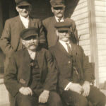 (Left to right) (Back row) Henry John Schmidt Sr. (1862-1951); Georg Karl Schmidt (1864-1933).  (Front row) Mike Lindemann (1860-1951); John A. Lindeman (1870-1933).  Henry and Karl Schmidt were first cousins. John and Mike Lindemann were also first cousins. The Schmidt boys and the Lindemann boys were also more distant cousins of one another.  Karl Schmidt was the son of Dietrich Schmidt Jr.  Henry Schmidt was the son of Conrad Schmidt.  Both Karl and Henry were the grandsons of Dietrich Schmidt Sr., great grandsons of Friedrich Schmidt, 2xgreat grandsons of Johannes Schmidt Jr., 3xgreat grandsons of Johannes Schmidt Sr., 4xgreat grandsons of Hans Heinrich Schmidt, and 5xgreat grandsons of Hans Schmidt.  Photo courtesy of Denise Lindemann