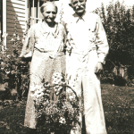 "Katharina Elisabeth Martha (Schmidt) Lindemann and Michael Lindemann (aka ""Lizzie"" and ""Mike"" Lindemann) in July of 1937. Here they are celebrating their 50th wedding anniversary on the farm of their son Carl Lindemann near Humboldt, Iowa.  ""Lizzie"" (Schmidt) Lindemann was the daughter of Conrad Schmidt, granddaughter of Dietrich Schmidt Sr., great granddaughter of Friedrich Schmidt, 2xgreat granddaughter of Johannes Schmidt Jr., 3xgreat granddaughter of Johannes Schmidt Sr., 4xgreat granddaughter of Hans Heinrich Schmidt, and 5xgreat granddaughter of Hans Schmidt.  Photo courtesy of Denise Lindemann"