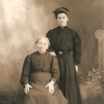 Martha Elisabeth (Lindemann) Schmidt (1837-1923) (seated) is here pictured with her granddaughter, Anna M. (Lindemann) Verbrugge (1888-1974) (standing).  Anna was the daughter of Mike and Lizzie (Schmidt) Lindemann, and the granddaughter of Conrad and Martha (Lindemann) Schmidt (pictured here).  Anna was also the great granddaughter of Dietrich Schmidt Sr., 2xgreat granddaughter of Friedrich Schmidt, 3xgreat granddaughter of Johannes Schmidt Jr., 4xgreat granddaughter of Johannes Schmidt Sr., 5xgreat granddaughter of Hans Heinrich Schmidt, and 6xgreat granddaughter of Hans Schmidt.  Photo courtesy of Denise Lindemann